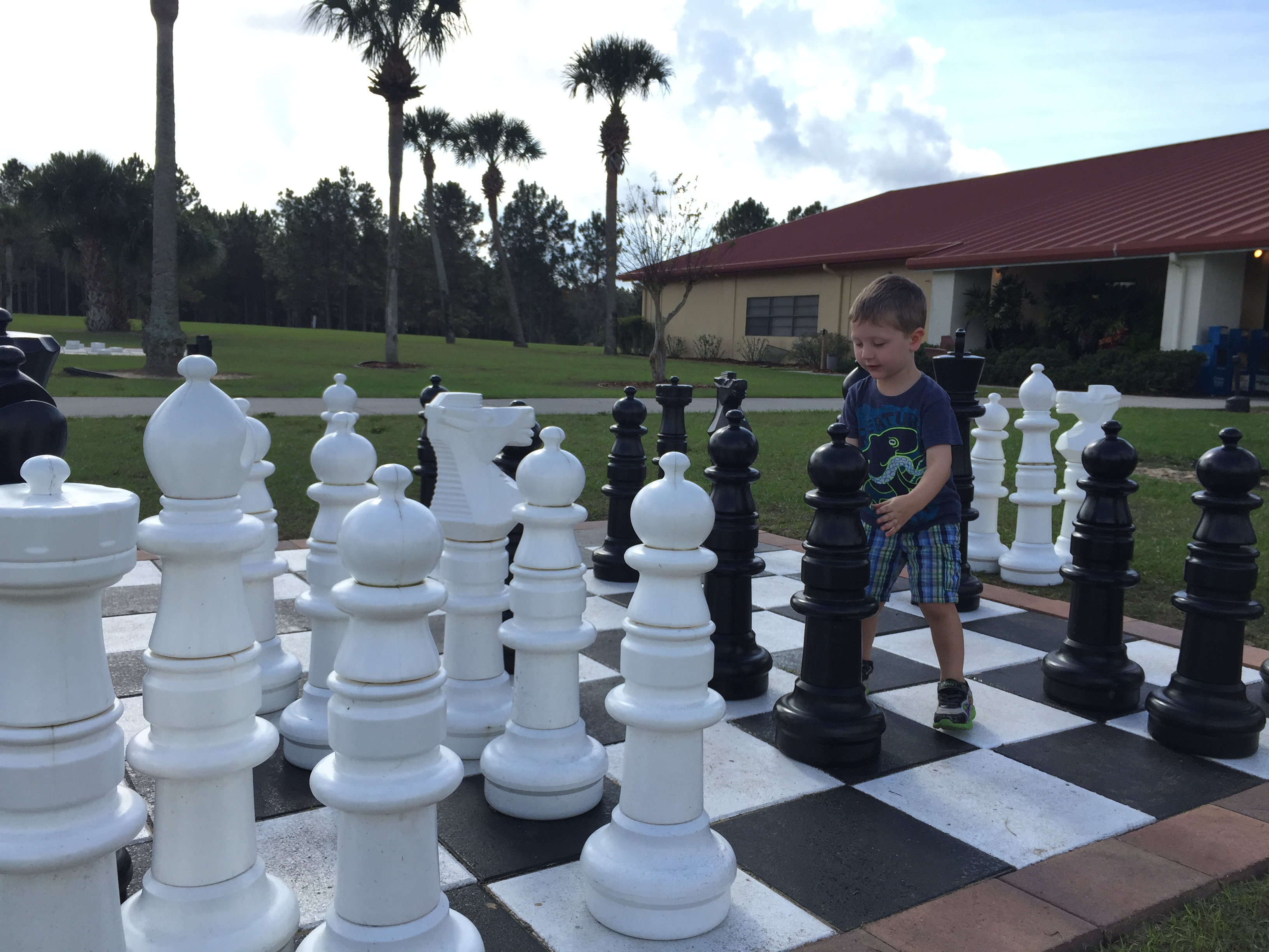 kid playing chess at a Thousand Trails campground