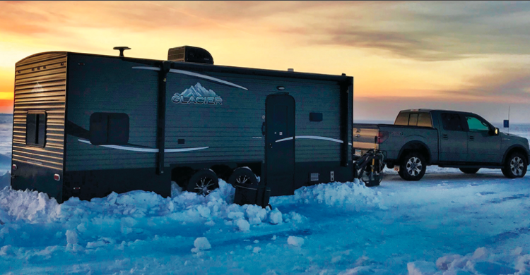 An Ice Fishing RV is towed behind a truck like any other travel trailer.