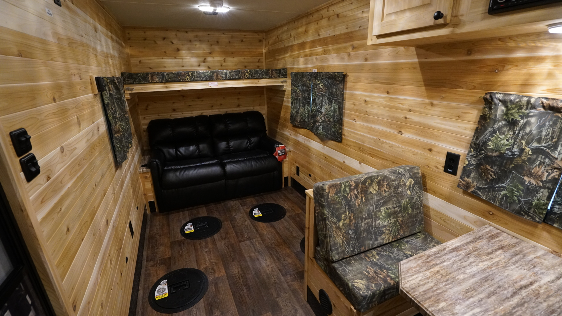 Fishing holes are built into the floor of an Ice Fishing RV