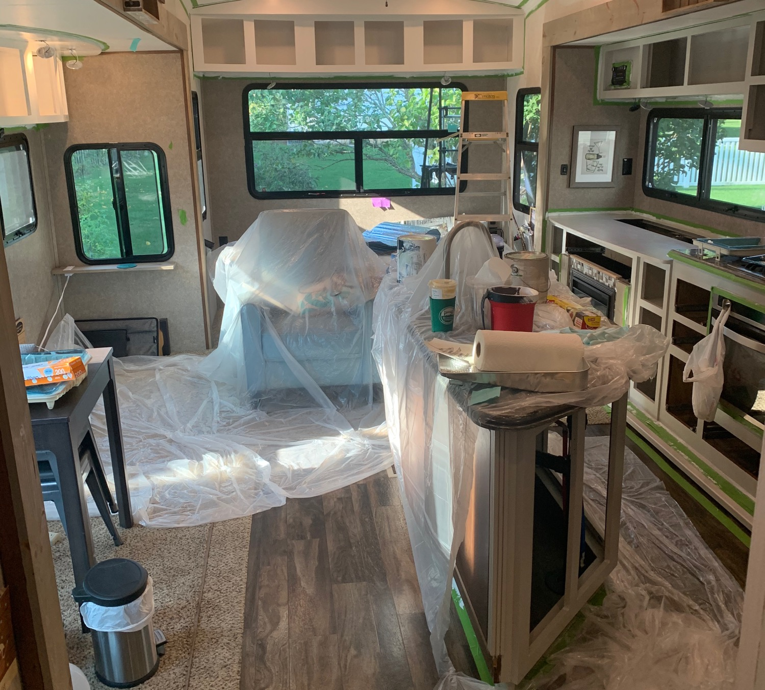 RV Makeover in progress: Painting interior cabinets white and light gray