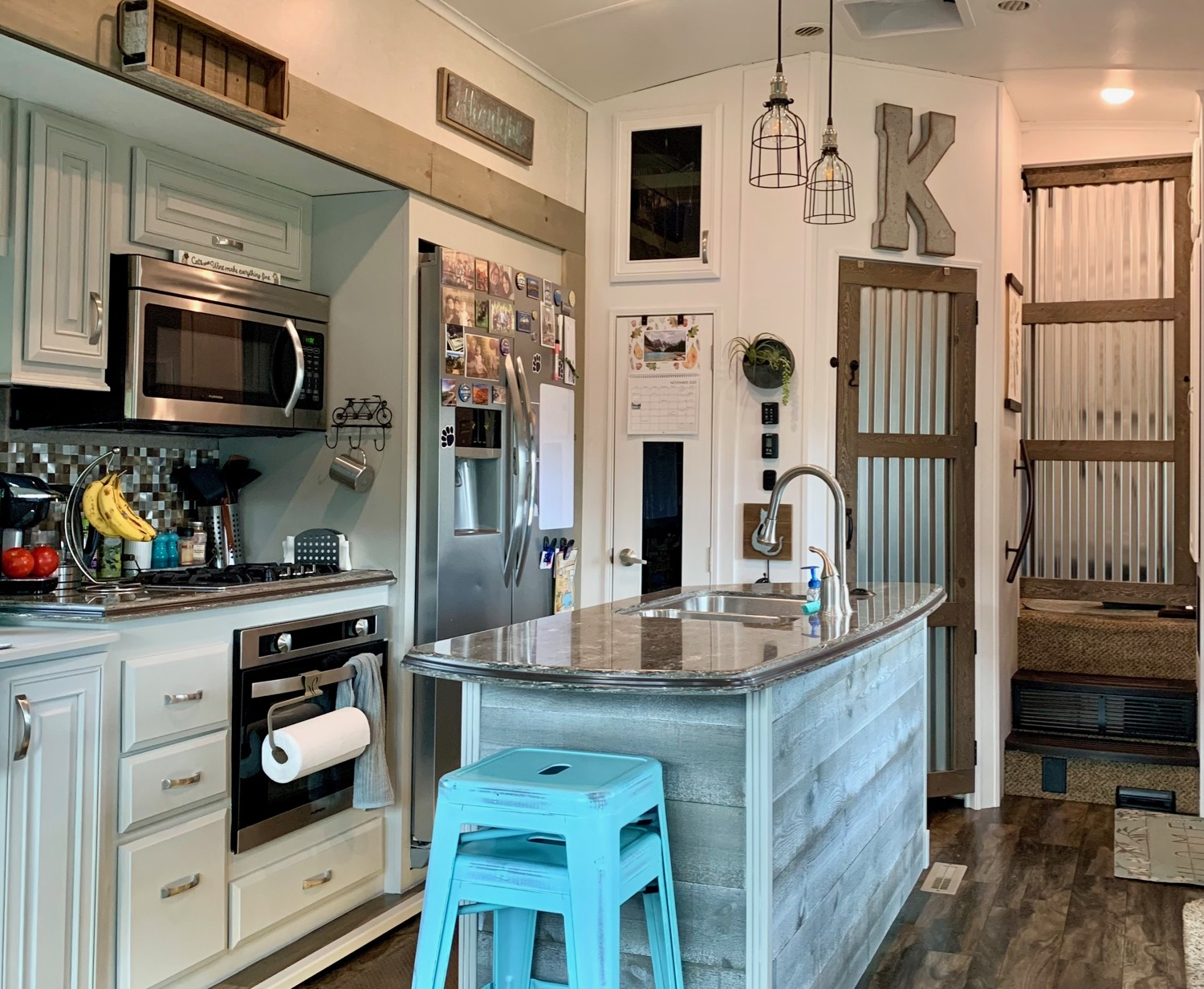 RV makeover: paint, doors, lighting, wood accent on island