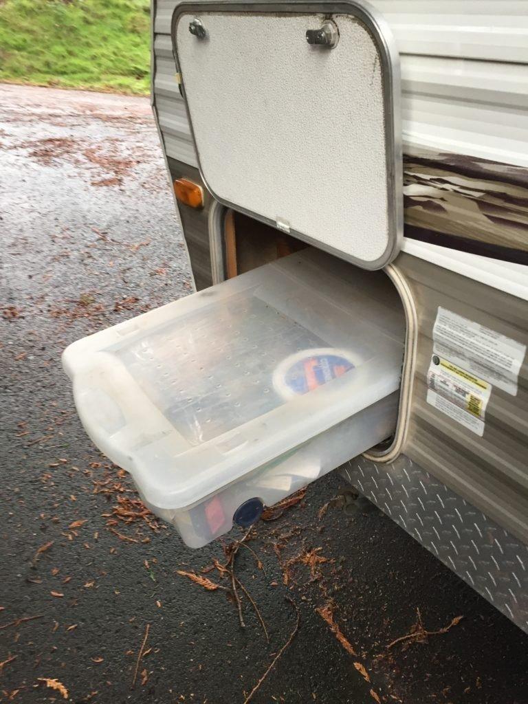 camper storage hacks - use a storage bin in an RV