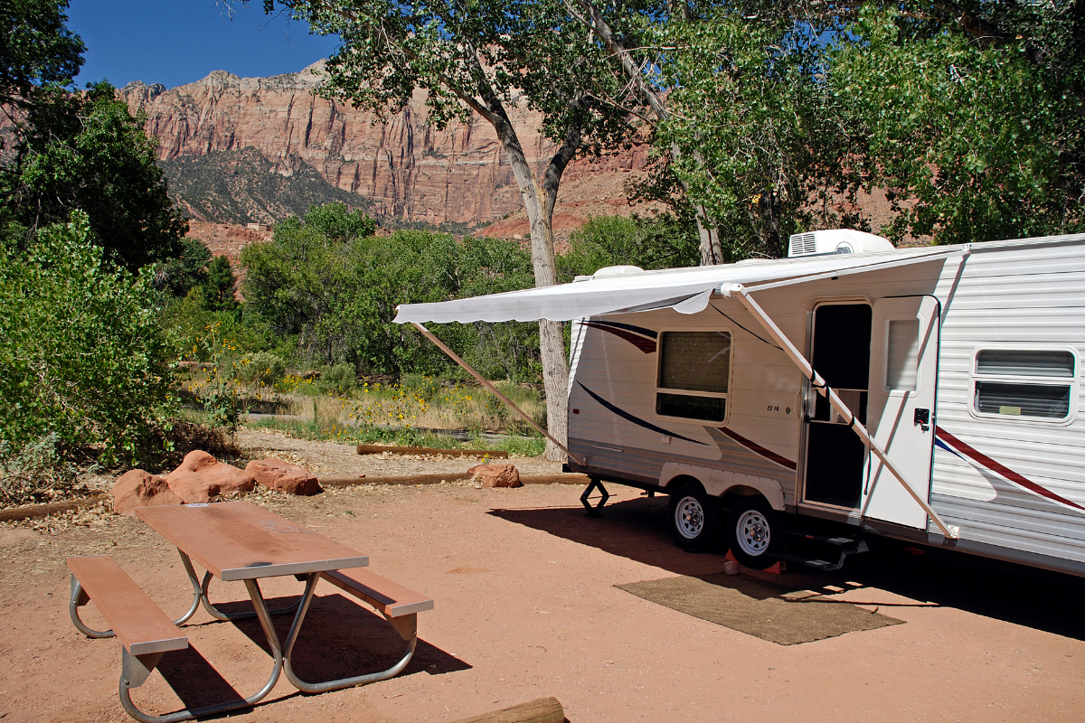RV awning replacement - RV awning extended at campsite