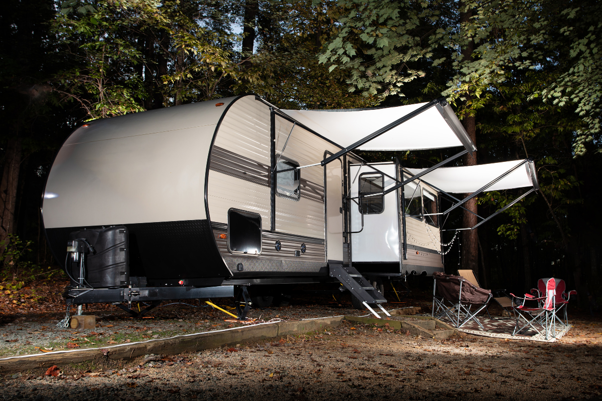 RV awning extended at night on travel trailer