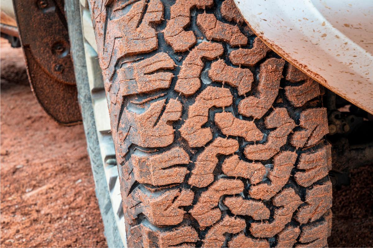All terrain tire on dirt road - camper van conversion