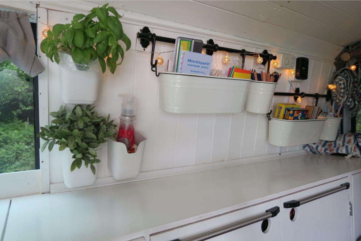 wall storage bins mounted in van- camper van conversion