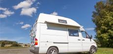 Side view of a camper van parked by a tree - DIY camper van