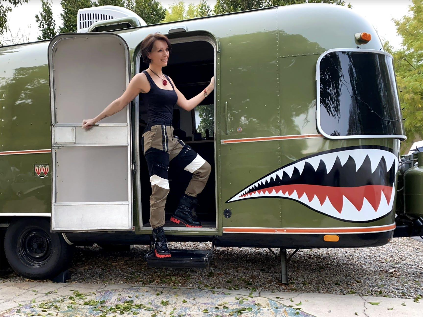 Owner in front of one of her Airstream renovations