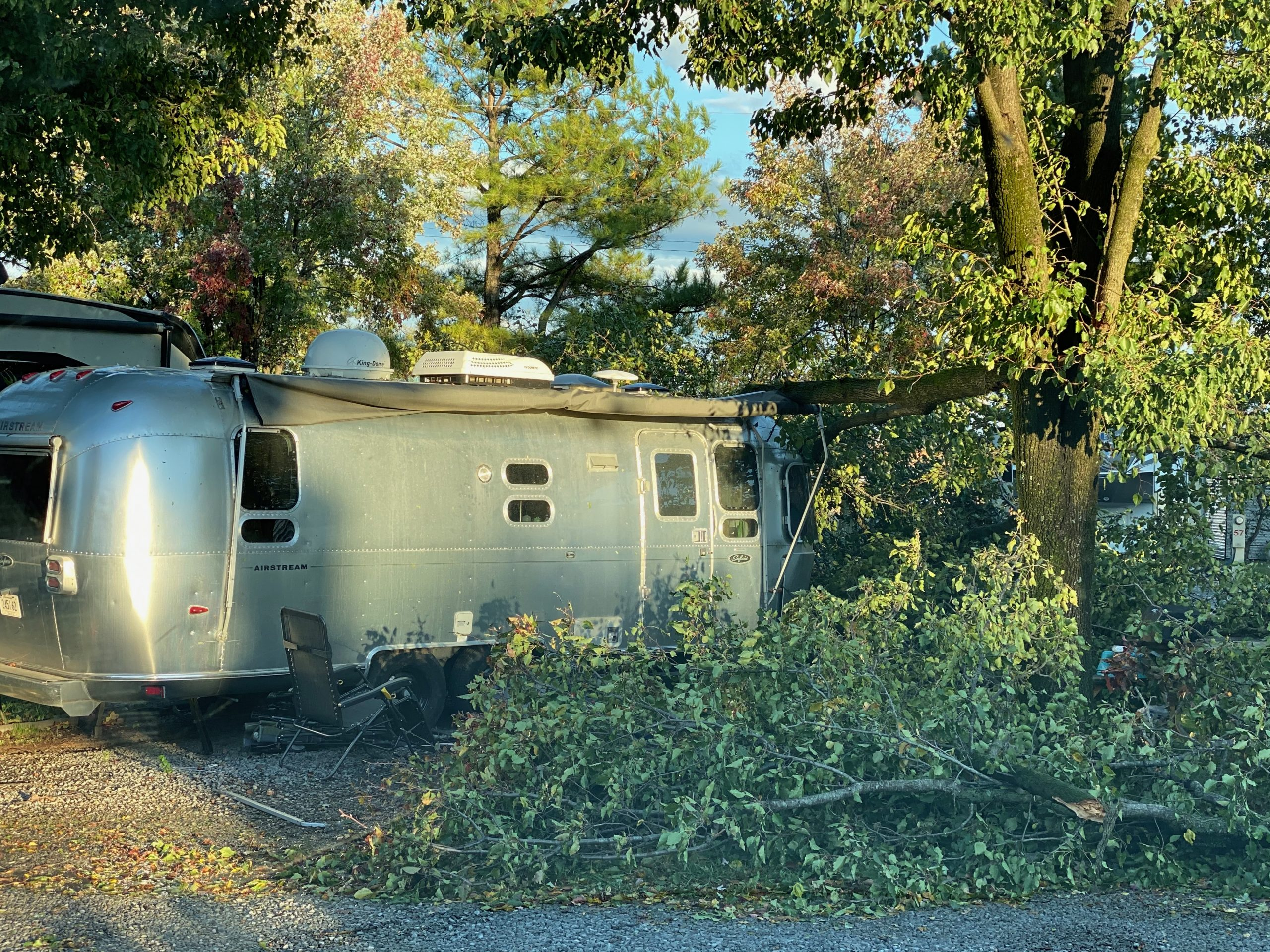 An Air Stream camper damaged in a windstorm would only be covered if the owner had comprehensive insurance coverage.