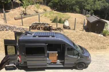 Sprinter van conversion costs vary based on attributes like the solar panels on the roof of this dark gray converted van
