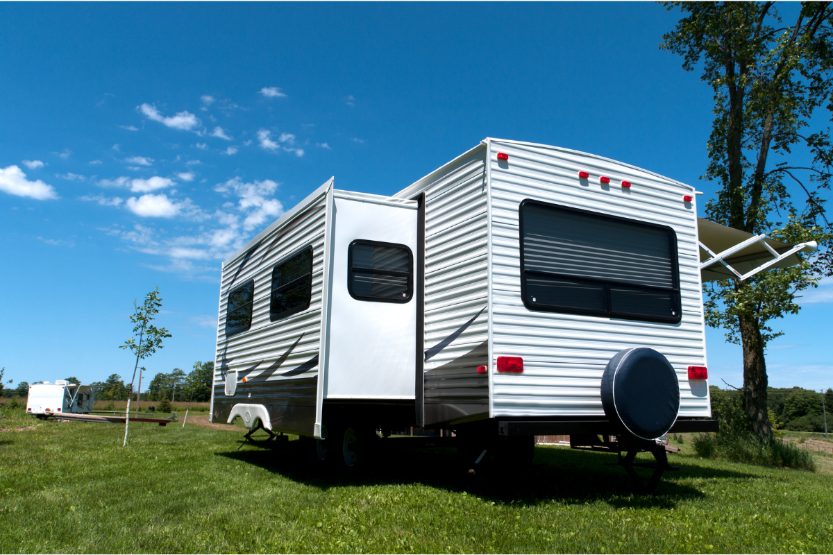 RV parked at a campsite with the slide-out extended - RV slide-outs