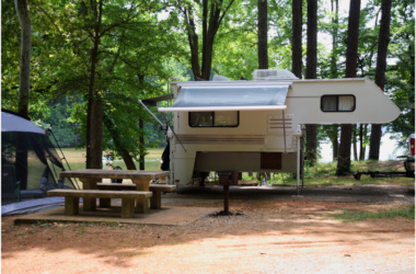 Truck camper removed from truck and set up on camper jacks on campsite - camper jacks