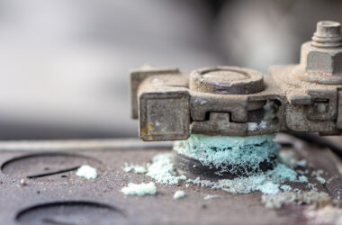 A corroded lead acid battery terminal