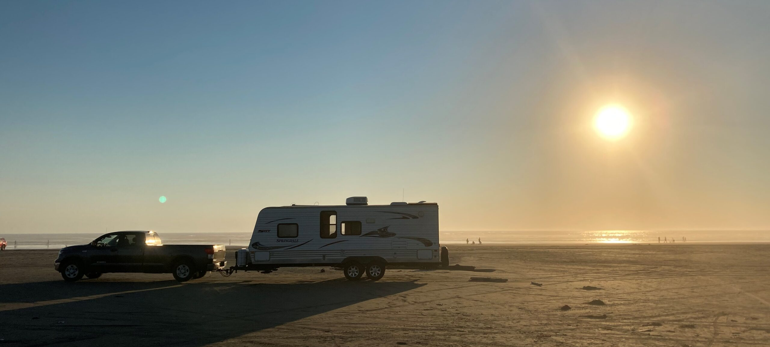 small RV cooling off at sunset