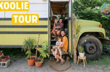 Skoolie tour text overlaid image of family of 4 sitting in skoolie conversion doorway